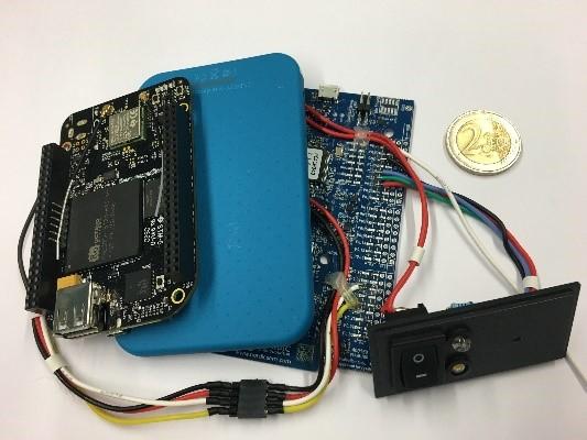 Imagen que contiene circuito, cámara  Descripción generada automáticamente